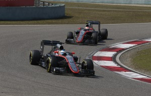 Fernando Alonso and Jenson Button on track.